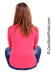 Back view of beautiful young woman sitting on the floo