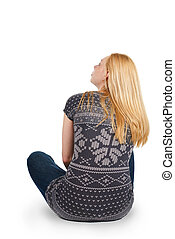 Back view of beautiful young woman sitting on the floor