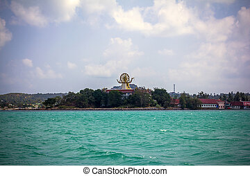 back view of big golden Buddha statue on the mountain above sea. Koh Samui