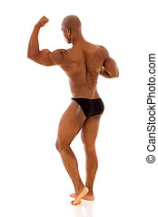 back view of black bodybuilder flexing muscle isolated on ...