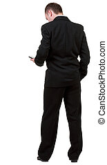 back view of business man in black suit  talking on mobile phone.    rear view people collection. Isolated over white background. backside view of person.