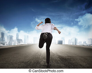 Back view of business man running