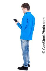 back view of business man uses mobile phone.
