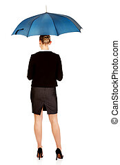 Back view of business woman holding an umbrella