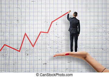 Back view of businessman drawing a red diagram standing on woman's hand.
