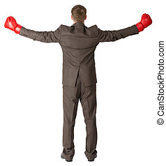 Back view of businessman in red boxing gloves