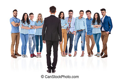 back view of businessman standing in front of his group