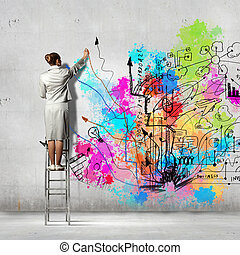 Back view of businesswoman drawing colorful business ideas ...