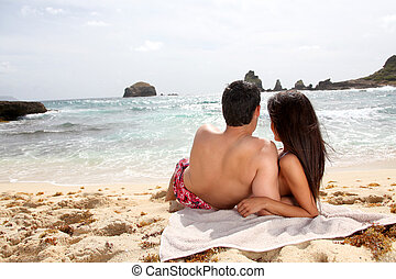 Back view of couple looking at the sea