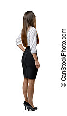 Back view of cutout businesswoman holding her hand on waist.  Business staff. Office clothes. Dress code. Presentable appearance. Beauty and youth.