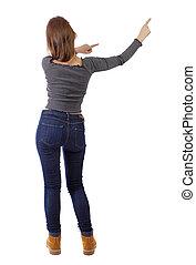 back view of dancing young beautiful woman.