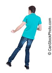 back view of dancing young man.