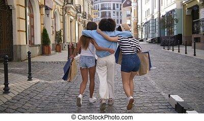 Back view of diverse fashion girls shopping