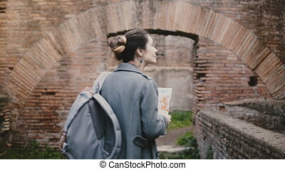 Back view of excited young female student researcher with...