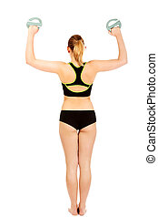 Back view of fitness woman exercising with weigh