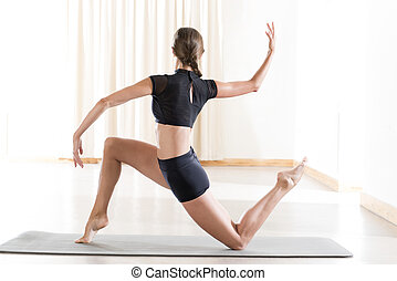 Back View of Girl in Black Crop Top Doing a Yoga Pose