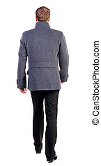 Back view of going handsome business man in coat. - Back...