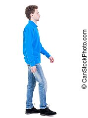 Back view of going handsome man. walking young guy