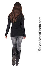 back view of going woman in jeans and sweater - back view of...