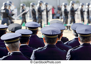 Japanese police officers - Back view of Japanese police...