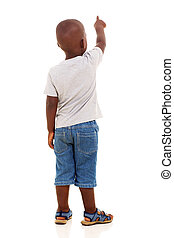 back view of little african boy pointing on white background