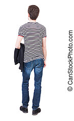 Back view of man in jeans. Standing young guy. Rear view...