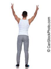 back view of man in undershirt celebrating
