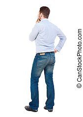 Back view of man . Standing young guy.