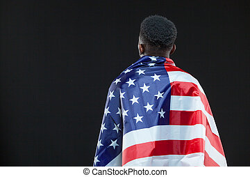 Back view of man wearing american flag isolated over black ...
