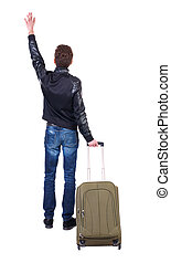Back view of man with green suitcase greeting waving