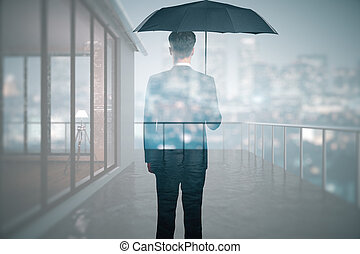 Protection concept - Back view of man with umbrella standing...