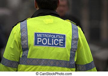 Back view of metropolitan police officer, westminster bridge, London, England, uk