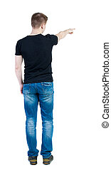 Back view of  pointing young men in  shirt and jeans. Young guy  gesture
