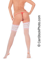 Back view of pretty woman in white stockings
