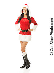 Back view of santa woman standing with hands on hips, looking at the camera
