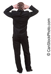 Back view of shocked business man in black suit