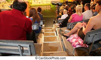 Back view of spectators in TV studio of channel NTV before...