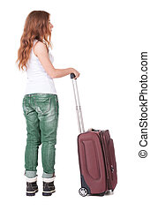 Back view of stylishly dressed woman with suitcase looking up