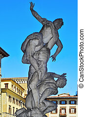 Back view of the ancient sculpture The Rape of the Sabine Women in the Loggia dei Lanzi, in Florence, Italy