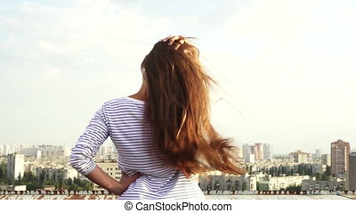 Back view of the girl and the panorama of the city