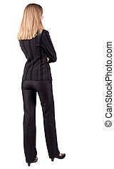 back view of thoughtful business woman contemplating
