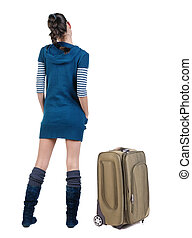 Back view of traveling brunette woman with suitcase