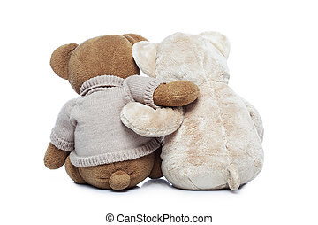 Back view of two Teddy bears hugging each other on white...