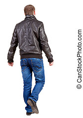 Back view of walking handsome man in jacket. - Back view of...