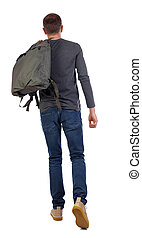back view of walking  man  with green bag.