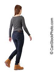 back view of walking woman.