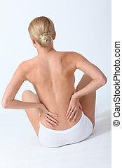 Back view of woman having backache