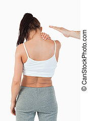 Back view of woman having neck pain