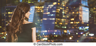 woman looking at night city