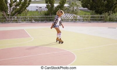Back view of woman on roller skates